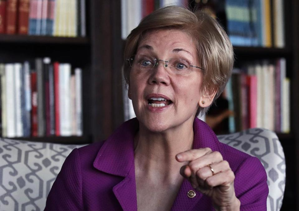 Sen. Elizabeth Warren, D-Mass. gestures as she answers a question during an interview at her office in Boston, Thursday, Dec. 15, 2016. (AP Photo/Charles Krupa)