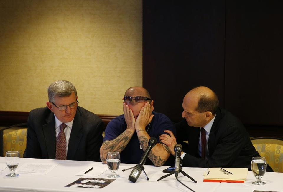 Attorney Mitchell Garabedian (right) comforted Bassam Haddad (center), who said he was abused by a priest, at a press conference Thursday.