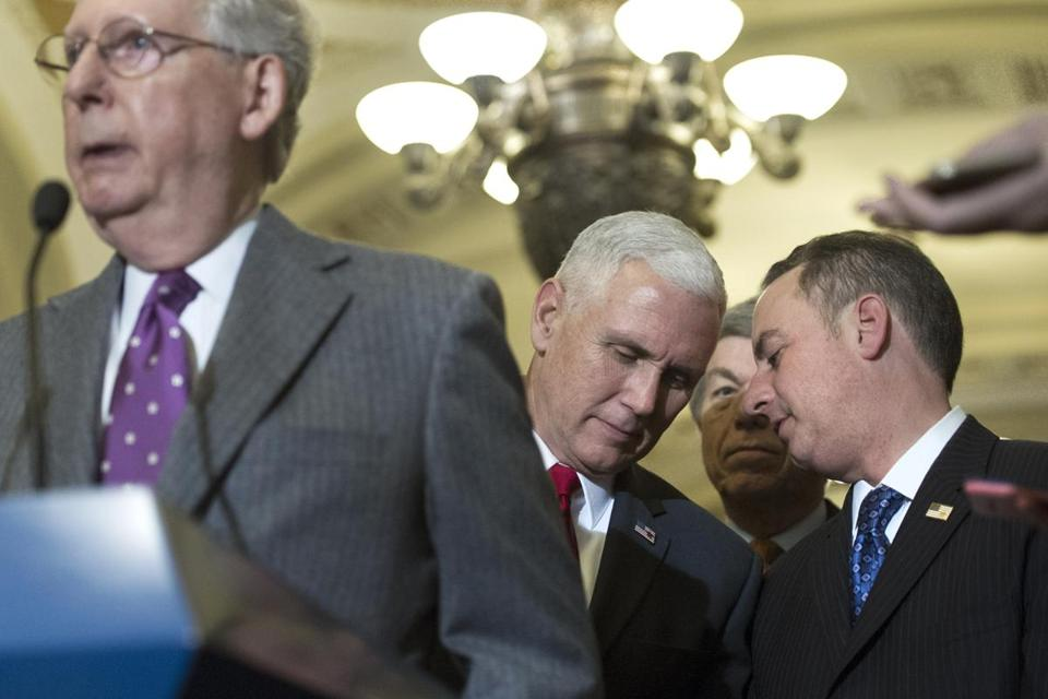Vice President-elect Mike Pence spoke with Reince Priebus, chief of staff for President-elect Donald Trump, right, as Senate Majority Leader Mitch McConnell spoke at a news conference last week.