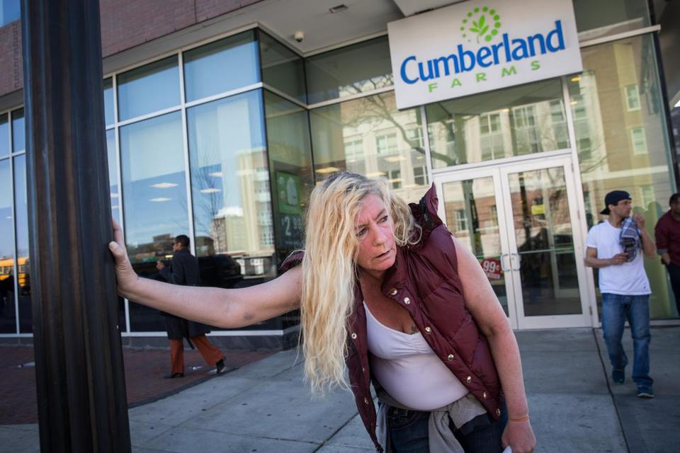 Sherry Gardner, a homeless woman, leaned against a light post in front of the Cumberland Farms store in April 2016.