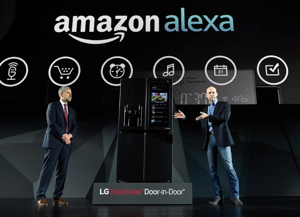LAS VEGAS, NV - JANUARY 04: LG Electronics USA Vice President of Marketing David VanderWaal (L) and Amazon Vice President of Alexa, Echo and Appstore Mike George display the LG Smart InstaView Door-in-Door refrigerator during a LG press event for CES 2017 at the Mandalay Bay Convention Center on January 4, 2017 in Las Vegas, Nevada. CES, the world's largest annual consumer technology trade show, runs from January 5-8 and is expected to feature 3,800 exhibitors showing off their latest products and services to more than 165,000 attendees. (Photo by David Becker/Getty Images)