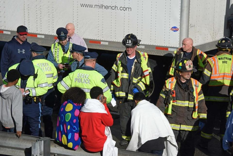 12buscrash - Waltham firefighters responded on Wednesday after a school bus rolled over on I-95 southbound in our city. (Peter Lobo/Waltham Fire Department)