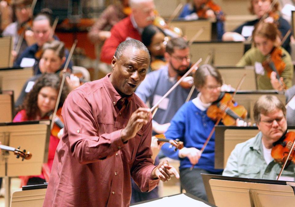 Conductor Thomas Wilkins led a group of amateur musicians in rehearsal at Symphony Hall.