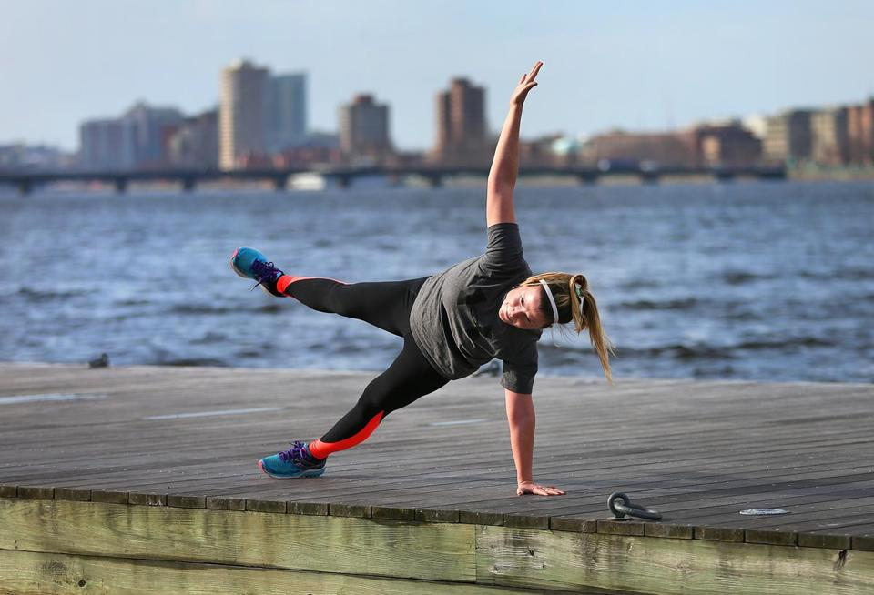 Sarah Coughlin from Dorchester practiced her yoga routine on a dock on the Charles River Esplanade on Thursday.