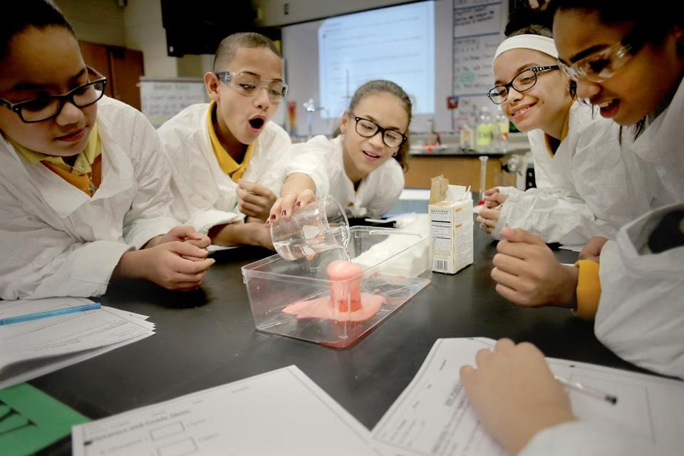 Lane TSpringfield, MA - 01/12/17 - Students react to a vinegar and baking soda volcano in Zoe Pierce's sixth grade science class at the Impact School in Springfield. There was no finger pointing here two years ago when state education officials threatened to take over three chronically low-achieving middle schools. Administrators and teachers alike knew students were not being well served and the schools needed to change. But Springfield officials from the mayor to the superintendent to the teachers union president did not welcome receivership. Instead, working with state officials, they crafted a first-of-its-kind plan for a Massachusetts school system, spinning off the middle schools into what effectively is their own miniature school system. Now that effort, dubbed locally as the Springfield Empowerment Zone Partnership, is gaining attention from state leaders and local educators across the state as a fresh way to potentially turn around the most persistently failing schools. (Lane Turner/Globe Staff) Reporter: (James Vaznis) Topic: (16springfield)