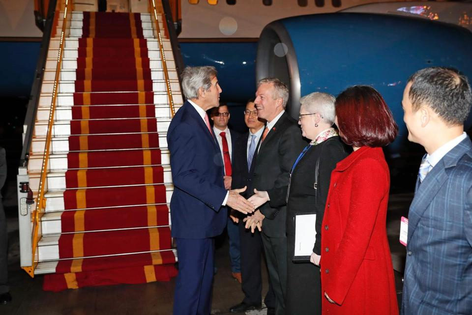 Secretary of State John Kerry (left) was greeted by US Ambassador to Vietnam Ted Osius and others at the Hanoi Airport in Vietnam on Thursday.