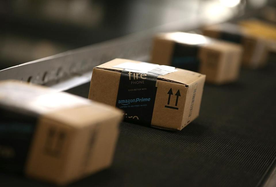 FILE - JANUARY 12: Amazon.com, the world's largest online retailer, said it will add 100,000 full-time U.S. employees over the next 18 months. TRACY, CA - JANUARY 20: Boxes move along a conveyor belt at an Amazon fulfillment center on January 20, 2015 in Tracy, California. Amazon officially opened its new 1.2 million square foot fulfillment center in Tracy, California that employs more than 1,500 full time workers as well as 3,000 Kiva robots that can fetch merchandise for workers and are capable of lifting up to 750 pounds. Amazon is currently using 15,000 of the robots spread over 10 fulfillment centers across the country. (Photo by Justin Sullivan/Getty Images)