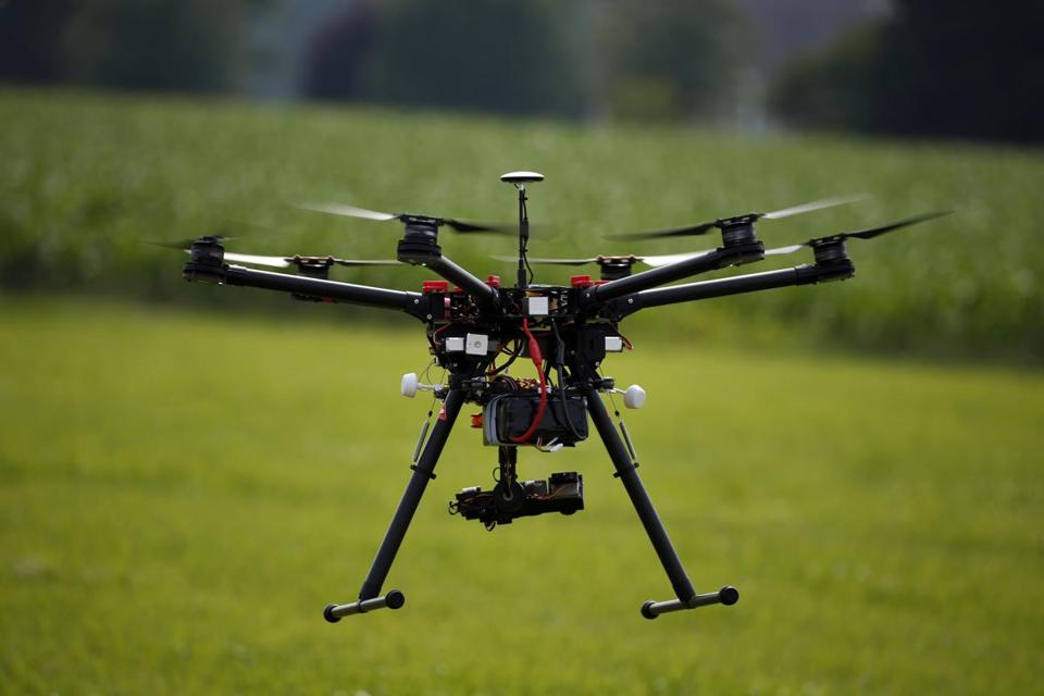 A hexacopter drone is flown during a drone demonstration at a farm and winery on potential use for board members of the National Corn Growers, Thursday, June 11, 2015 in Cordova, Md. Routine commercial use of small drones got a green light from the Obama administration June 21, 2016, after years of struggling to write regulations that would both protect public safety and unleash the economic potential and societal benefits of the new technology. (AP Photo/Alex Brandon)