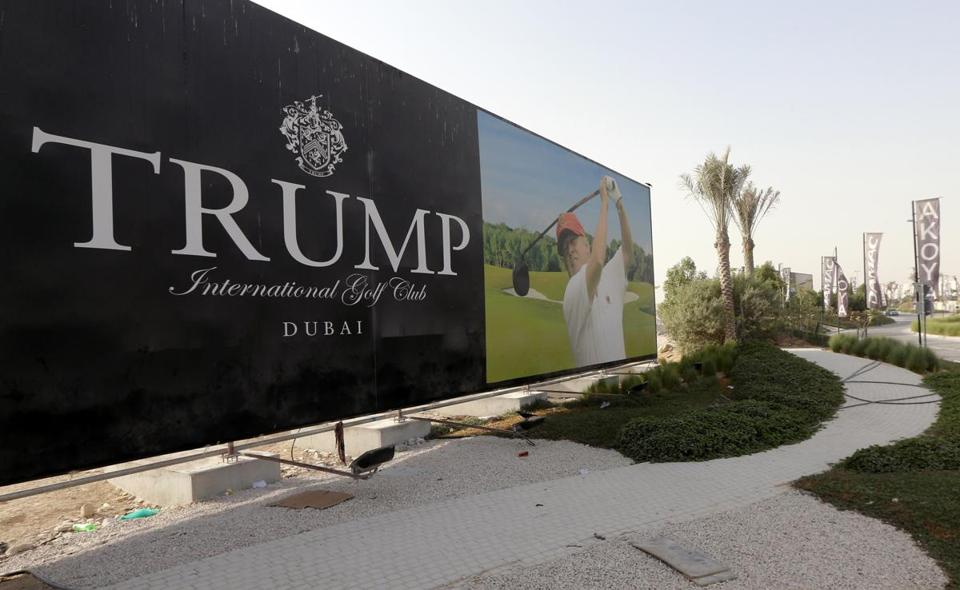 US real-estate magnate Donald Trump is seen playing golf on a billboard at the Trump International Golf Club Dubai in the United Arab Emirates on August 12, 2015. The empire of White House hopeful Donald Trump outside the United States extends to 12 countries including Turkey, South Korea, India, Brazil, and the United Arab Emirates. AFP PHOTO / KARIM SAHIB (Photo credit should read KARIM SAHIB/AFP/Getty Images)