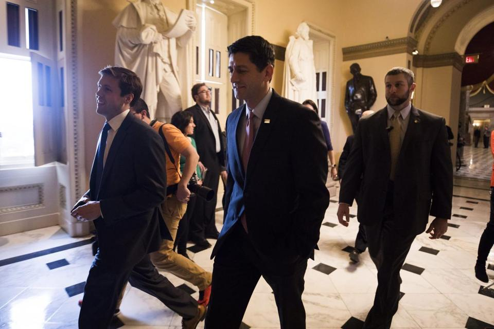 epa05715772 Republican Speaker of the House From Wisconsin Paul Ryan (C) walks to the House floor where representatives were voting on a budget resolution that is the first step in repealing the Affordable Care Act in Washington, DC, USA, 13 January 2017. Should the measure pass, House members will begin drafting legislation to repeal President Obama's signature legislation, commonly known as Obamacare. EPA/JIM LO SCALZO