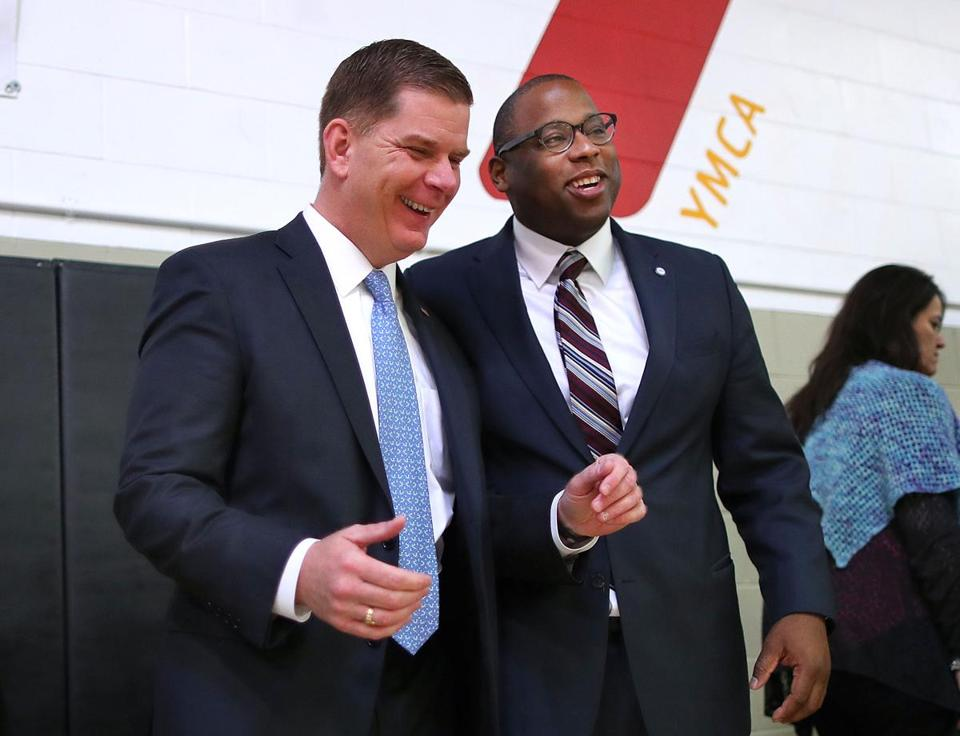 Boston Mayor Marty Walsh and Councilor Tito Jackson share a light moment at the annual MLK Breakfast at the Roxbury YMCA.