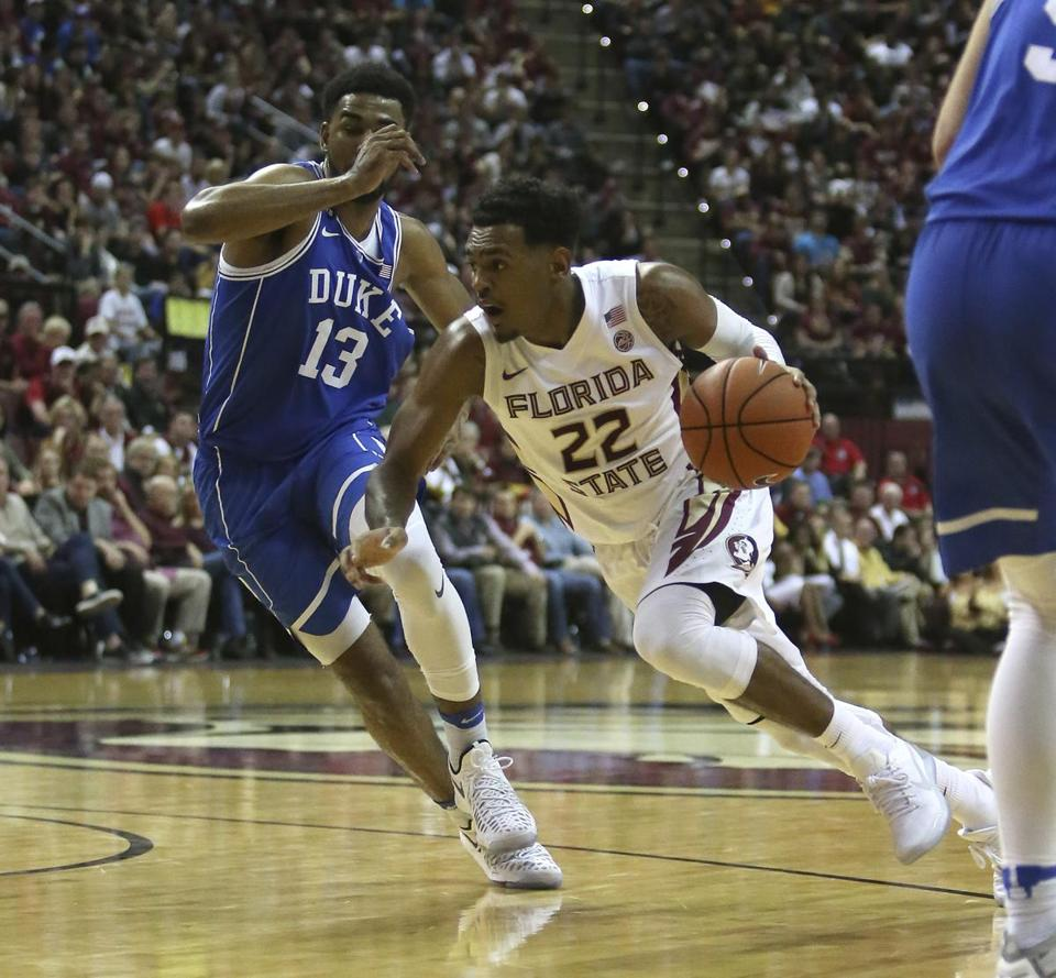 Florida State's Xavier Rathan-Mayes drives the ball up court against Duke's Matt Jones in the second half of an NCAA college basketball game, Tuesday, Jan. 10, 2017, in Tallahassee, Fla. Florida State won 88-72. (AP Photo/Steve Cannon)
