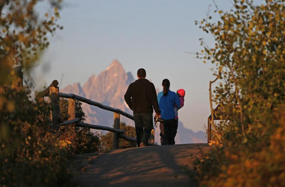 Visitors and their baby strolled near mountain peaks in Grand Teton National Park, Wyo.