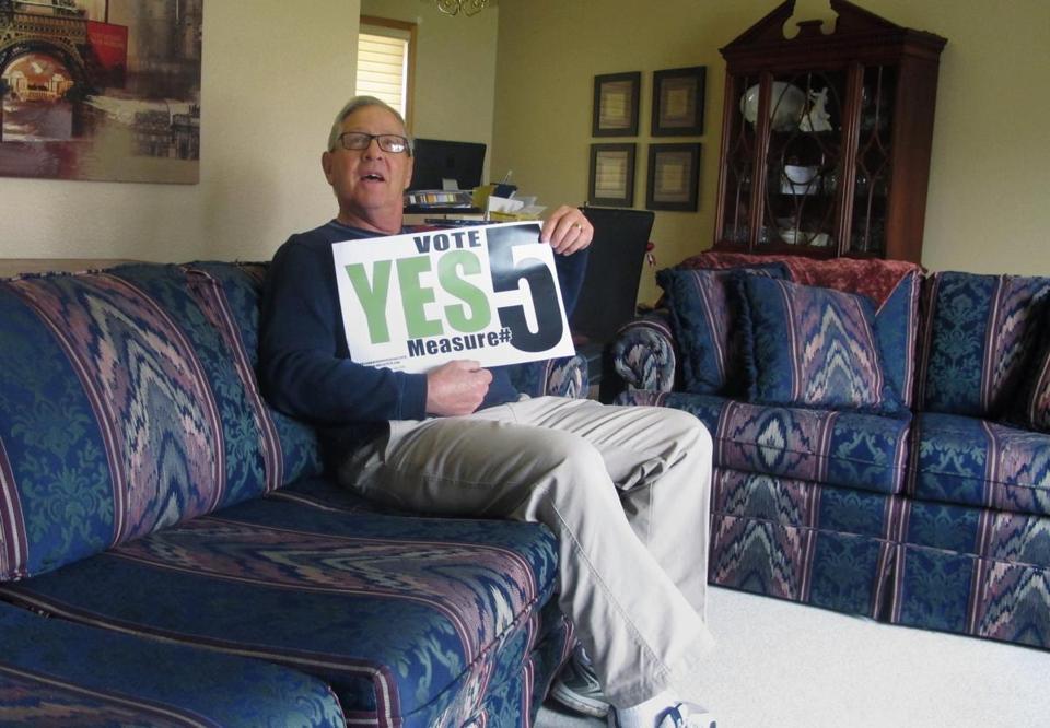 Financial Adviser Rilie Ray Morgan Of Fargo, N.D., Last October Held A Sign  Promoting