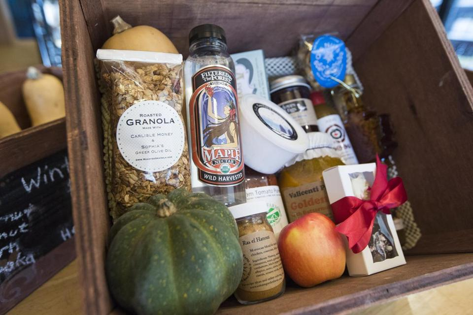 A box of locally sourced products sits on a table at Wildflower Pantry.