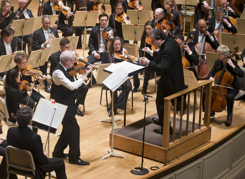 Guest conductor Juanjo Mena leads violinist Gidon Kremer and the Boston Symphony Orchestra Thursday.