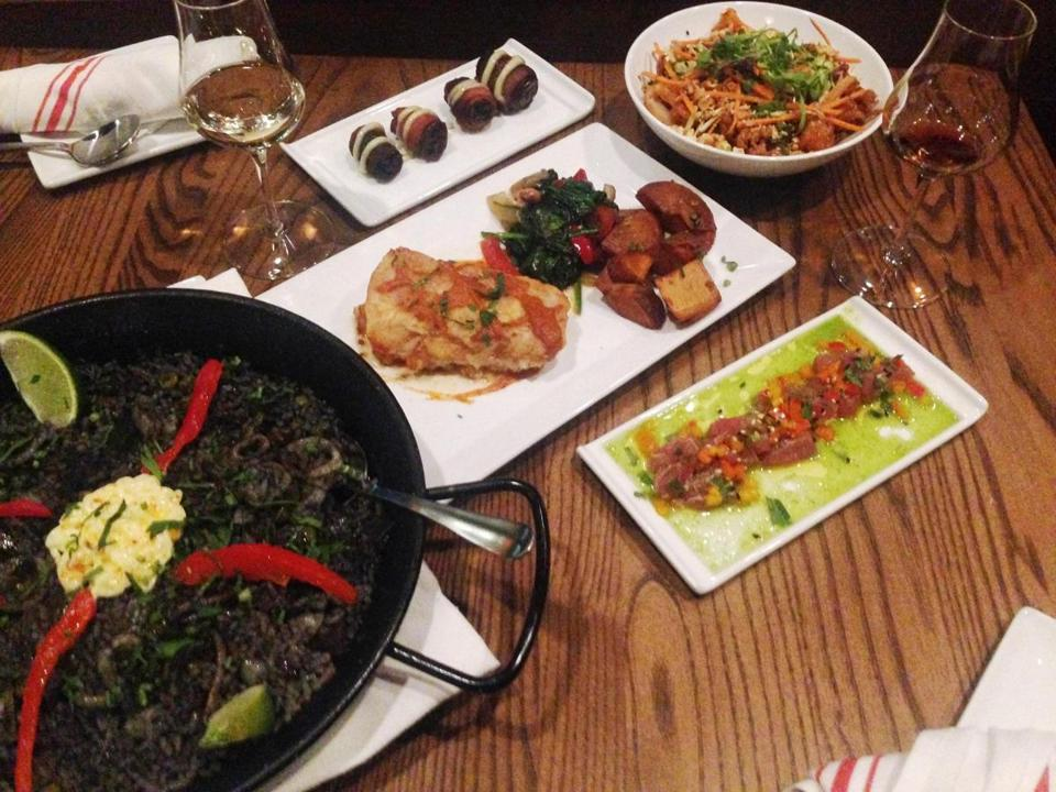 29nodine - The goal at TÕahpas 529 is a meal shared. Before you know it, the table fills with tapas, small plates of food like bacon-wrapped dates, a crispy calamari salad, a rice-based paella dish, and main entree, like Bacalao a la Vizcaina (pan-seared cod with a confetti of nuts, dried fruit sauteed into the spinach, plus potatoes), and glasses of wine and Madeiras. (Kathy Shiels Tully)