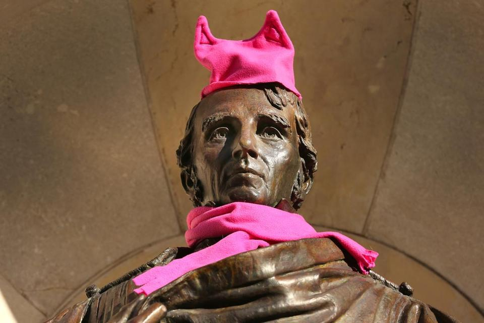 Boston-01/21/2017 Thousands of people filled Boston Common for the Boston Women's March for America. Someone adorned the statue of William Ellery Channing with a pink knit hat and scarf. The staue is on Arlington Street at the Boston Public Garden. John Tlumacki/Globe Staff(metro)