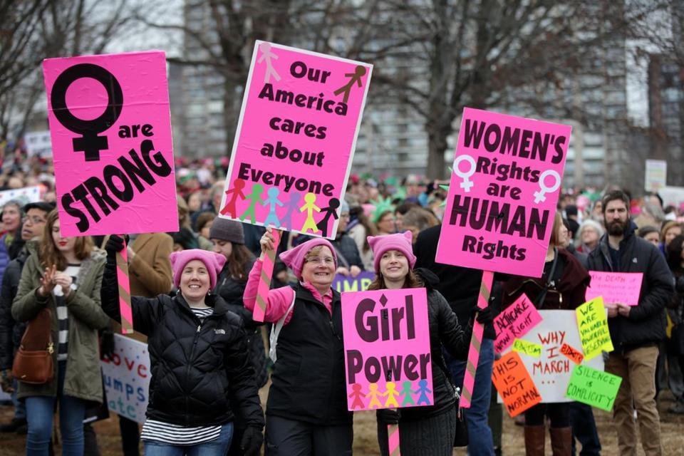 Women held signs on the Common.