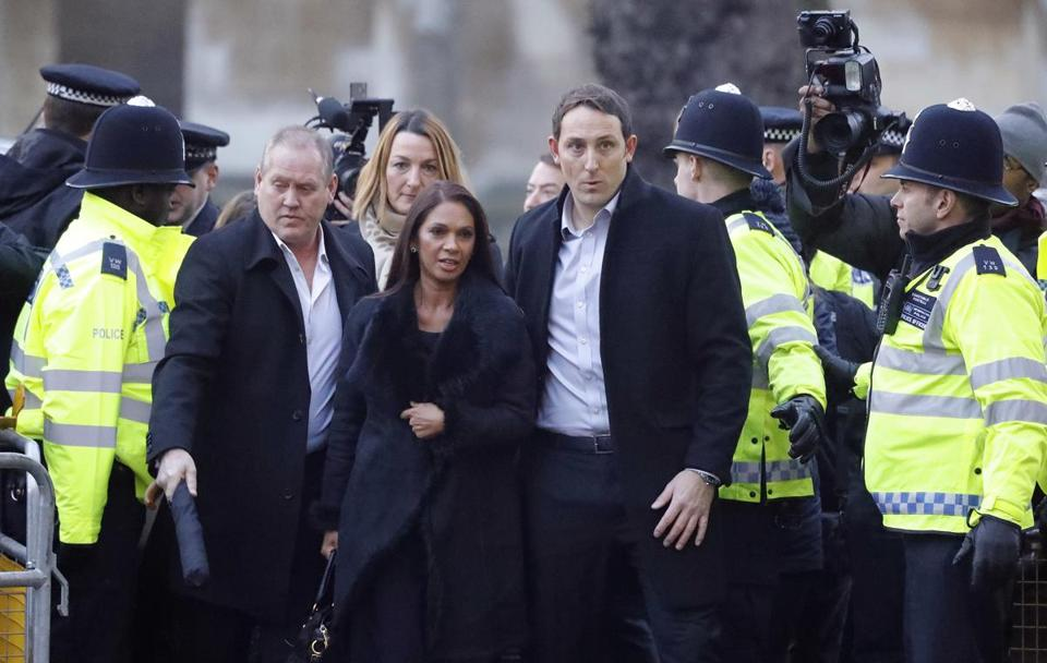 Gina Miller (center), a founder of investment management group SCM Private and the lead plaintiff in the case claiming that Parliament must approve Britain's exit from the European Union, arrived at the Supreme Court in London on Tuesday.