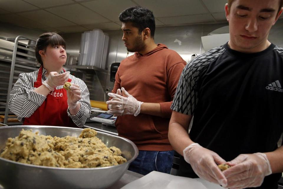 Divitto instructed workers Ronak Maheshwari, center, and Nathan Rosenstein while they made her cookie recipe.