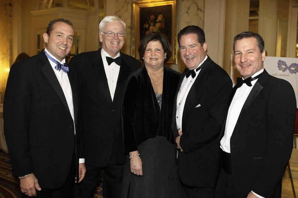 At the Boys and Girls Club of Dorchester Grand Carnivale Gala, held at the Fairmont Copley Hotel, Dan Flynn (second from right) posed with officials from the organization, including Lee Michael Kennedy (left), who is CEO of a construction company Flynn defrauded.