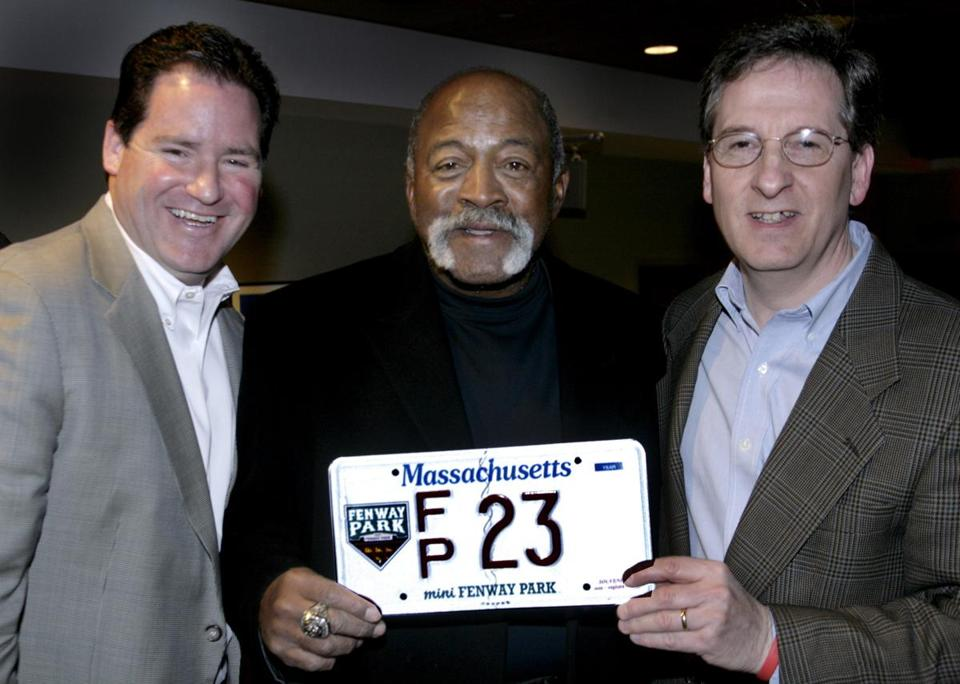 Dan Flynn posed with former Red Sox pitcher Luis Tiant and Ron Lacobucci of Quincy during a license plate auction event at Fenway Park in 2007.