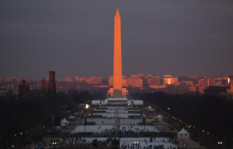 The crowd starts to fill the National Mall as the sun rises before the swearing in of Donald Trump as the 45th President of the Untied State during the 58th Presidential Inauguration at the U.S. Capitol in Washington. Friday, Jan. 20, 2017. (AP Photo/Carolyn Kaster)