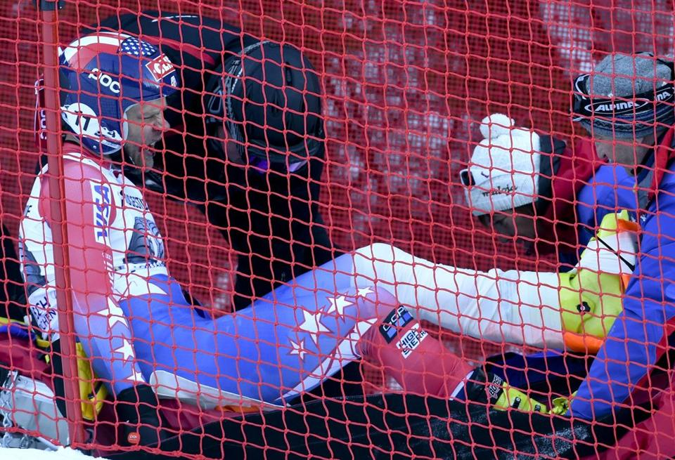 Steven Nyman is assisted after crashing during an downhill race in Garmisch Partenkirchen, Germany on Friday.