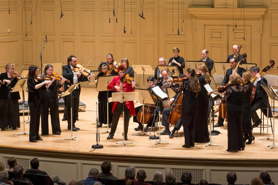 Aisslinn Nosky (center) leads the Handel and Haydn Society orchestra in Mozart's Violin Concerto in G Major during Friday's performance.