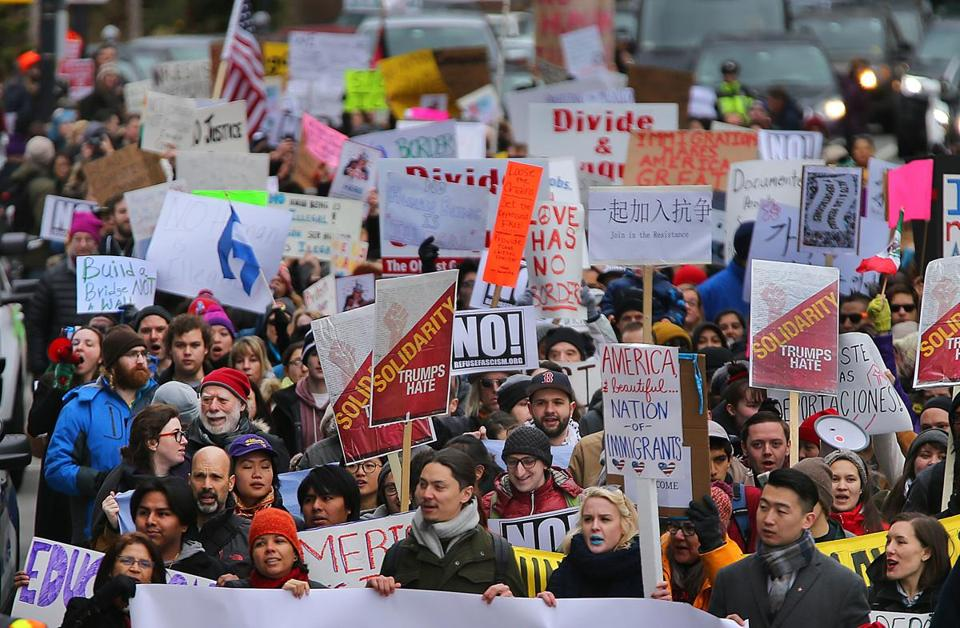 Hundreds rally in Boston against Trump's immigrant ...