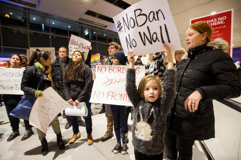 Devlin Doran, 6, and her mother Meghan Doran protested the recent immigration bans at Boston Logan Airport's Terminal E for international arrivals.