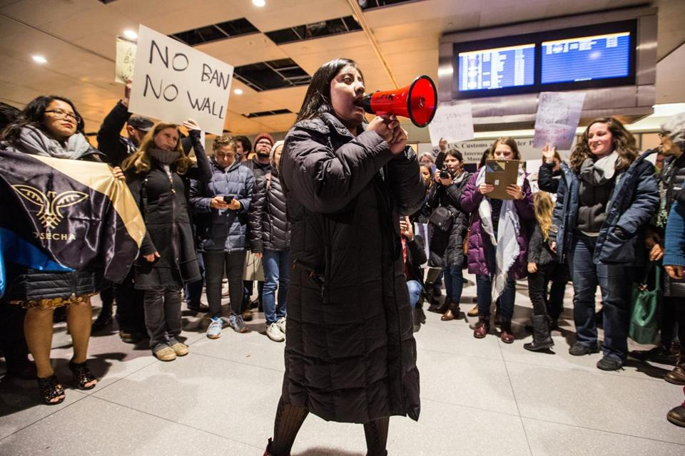 Catalina Santiago, 19, spoke in protest of the recent immigration bans at Boston Logan Airport's Terminal E for international arrivals.