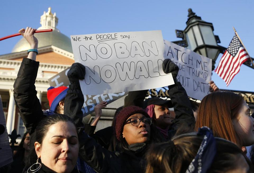 Protesters gathered at the Massachusetts State House to protest President Trump's executive order banning people from several predominantly Muslim countries from entering the country.