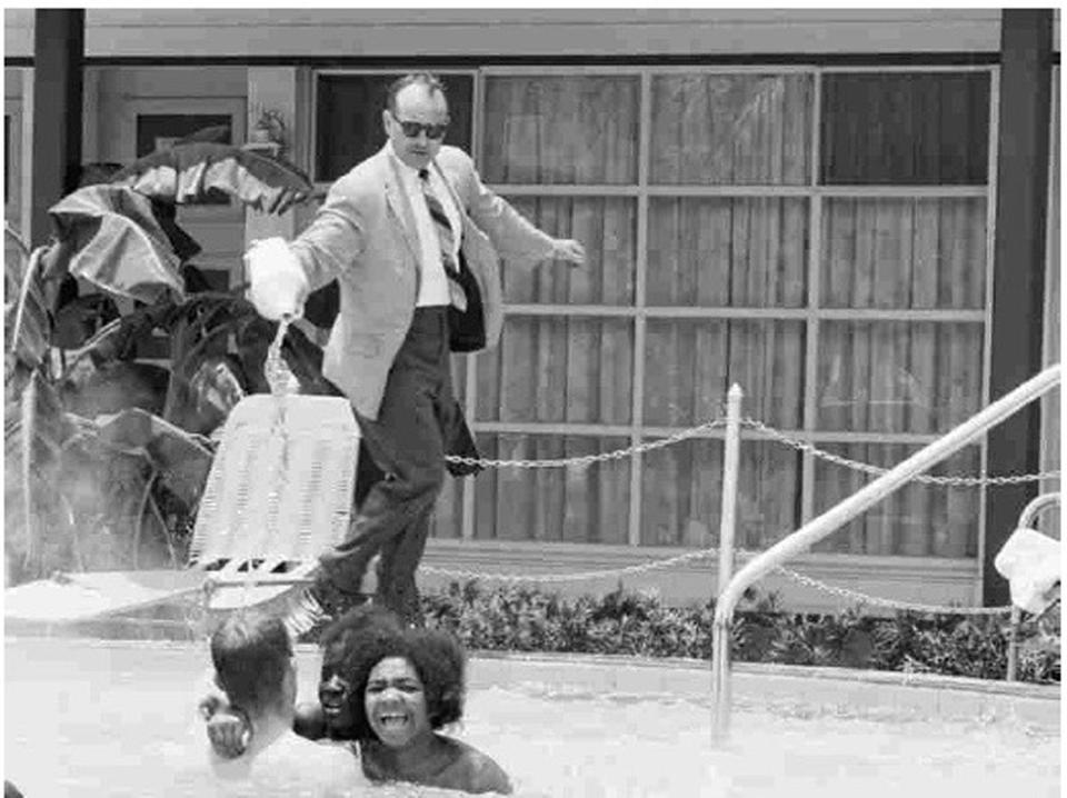 "A motel owner pours acid near Mimi Jones of Roxbury during a protest at a whites-only pool in St. Augustine, as seen in the documentary ""Passage at St. Augustine."""