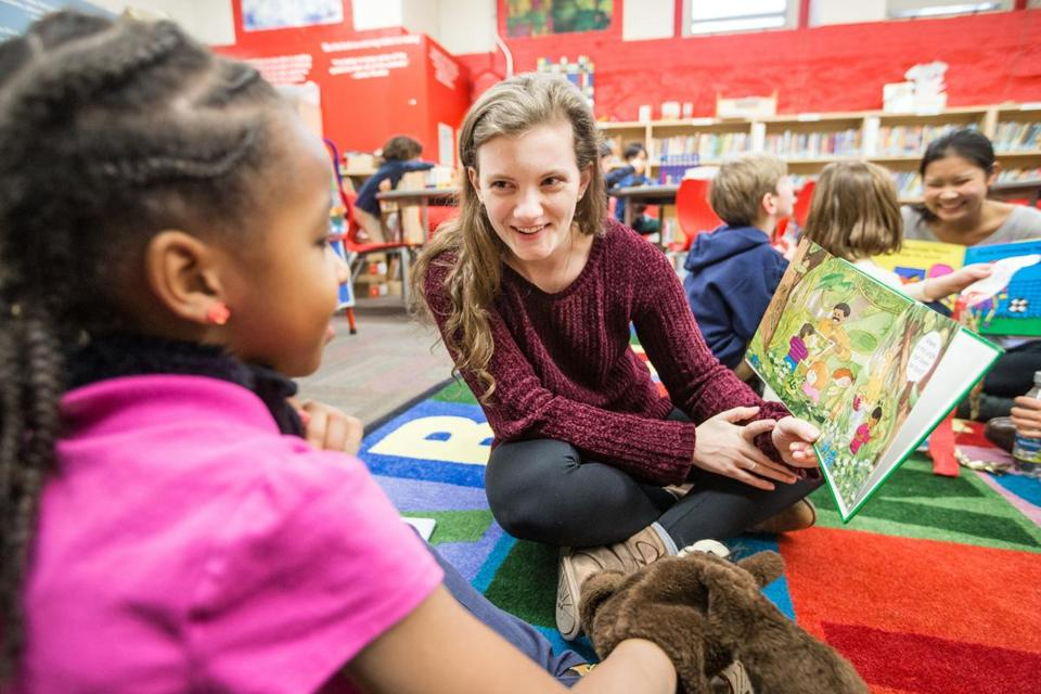 "01/30/2017 DORCHESTER, MA Brookline High School Senior Haley Evans (cq) 18, reads to a student at Mather Elementary School in Dorchester during an after school mentoring session. Evans raises money for her charity called ""Found Money Charity"" by helping people reclaim money from unclaimed money lists. **Note: not permitted to show students faces or identify them.*** (Aram Boghosian for The Boston Globe)"