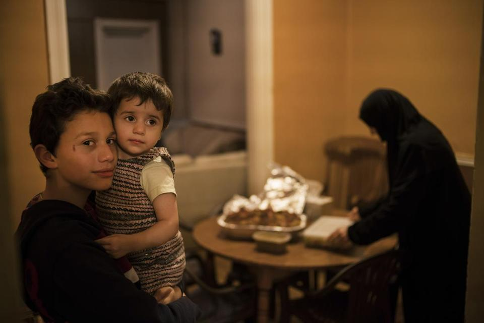 Members of a Syrian refugee family who arrived seven months ago prepare a meal for another family about to arrive to their new home in Lancaster, Pa., Dec. 7, 2016. Last year, the Church World Service's Lancaster office helped resettle 407 of the 85,000 refugees admitted into the United States, part of a rich history of acceptance rooted in the Mennonite and Amish faith, among others. (Todd Heisler/The New York Times)