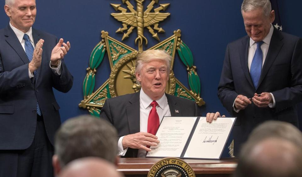 The executive order Trump signed late Friday puts a temporary moratorium on travel from seven countries while encouraging an effort to tighten the country's screening of potential terrorists.