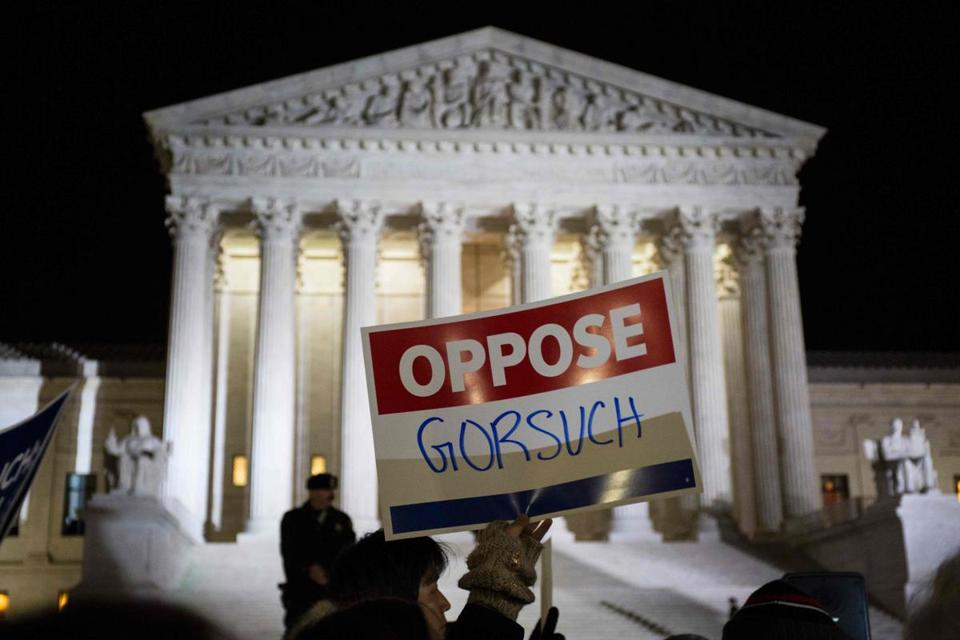 Demonstrators gather outside of The United States Supreme Court after President Donald Trump announced Neil Gorsuch as his nominee to fill the seat of former Associate Justice of the Supreme Court Antonin Scalia in Washington, DC, on January 31, 2017. President Donald Trump nominated federal appellate judge Neil Gorsuch as his Supreme Court nominee, tilting the balance of the court back in the conservatives' favor. / AFP PHOTO / ZACH GIBSONZACH GIBSON/AFP/Getty Images