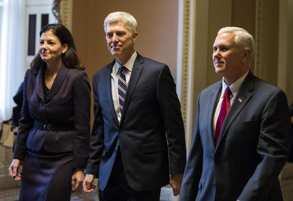 Supreme Court nominee Judge Neil Gorsuch (center), along with Vice President Michael Pence (right) and former Republican Senator from New Hampshire Kelly Ayotte.