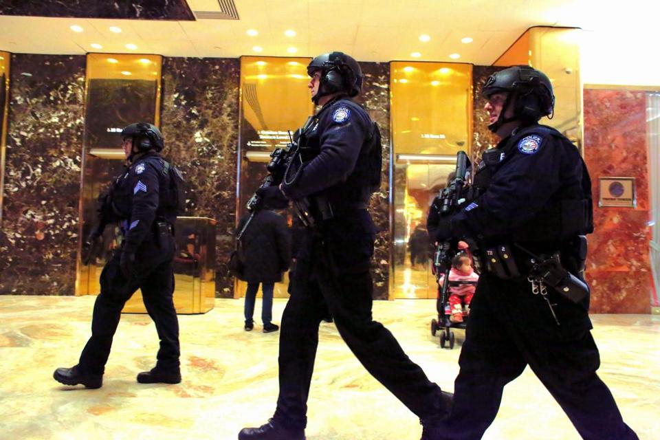 New York Police Department (NYPD) counterterrorism officers patrol inside the Trump Tower on January 3, 2017 in New York. / AFP PHOTO / KENA BETANCURKENA BETANCUR/AFP/Getty Images