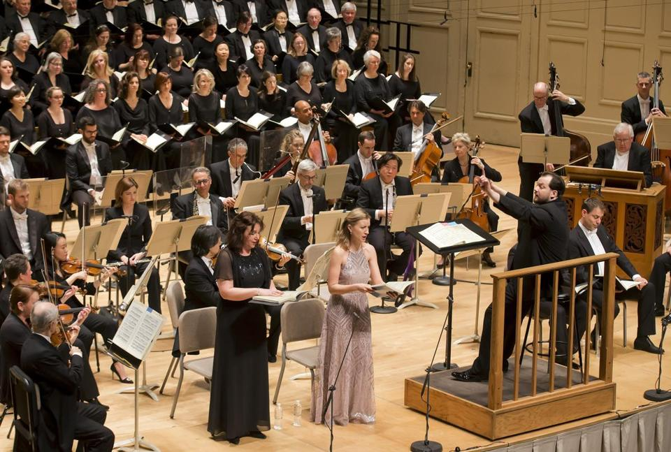 Andris Nelsons (right) leads the BSO and (from left) mezzo-soprano Christine Rice and soprano Malin Christensson at Symphony Hall Thursday night.