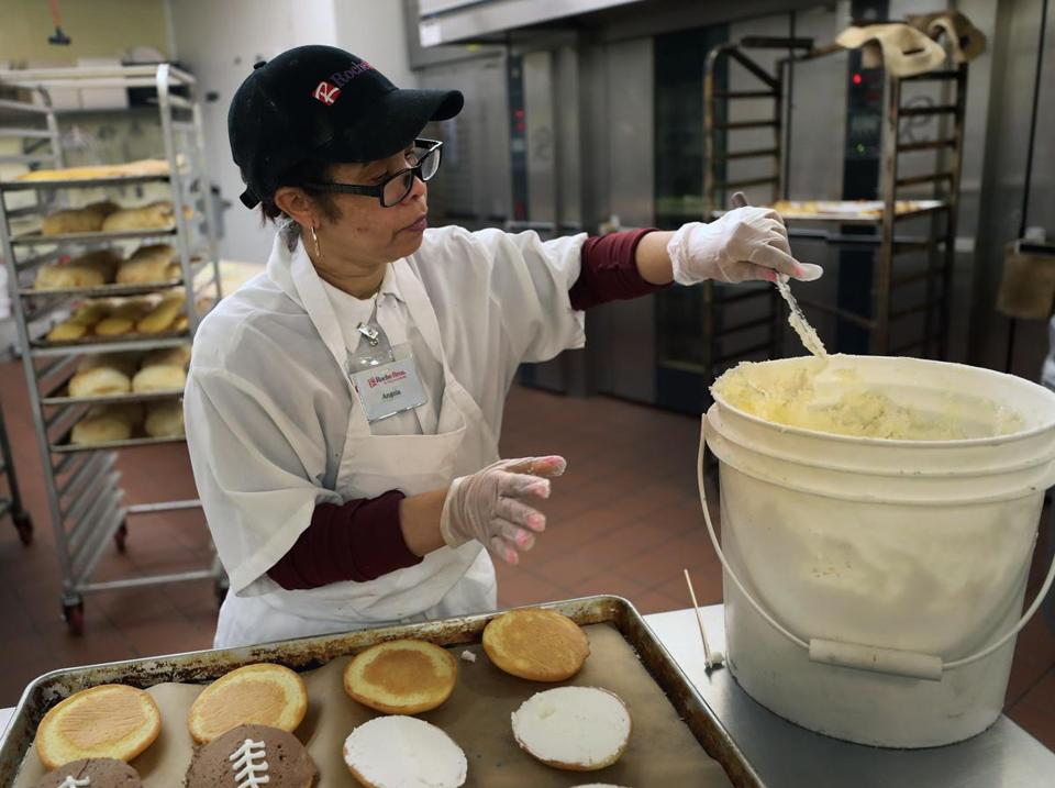 QUINCY, MA - 2/02/2017: Employee Angela Goncalves (cq) working in the bakery at Roche Brothers bakery in the Quincy store. Recruitment officials at the store say that its never been harder to find qualified workers to fill positions, particularly bakers. The company could use up to six new bakers. (David L Ryan/Globe Staff Photo) SECTION: BUSINESS TOPIC 07bakers