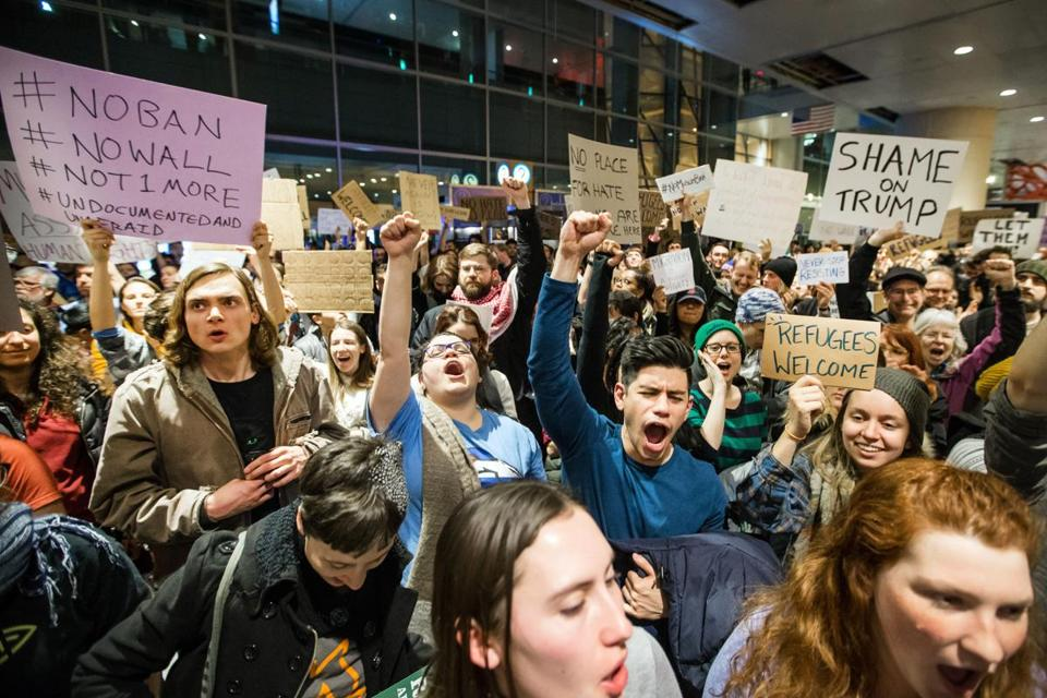 Demonstrators at Logan Airport protested against the ban Tuesday.