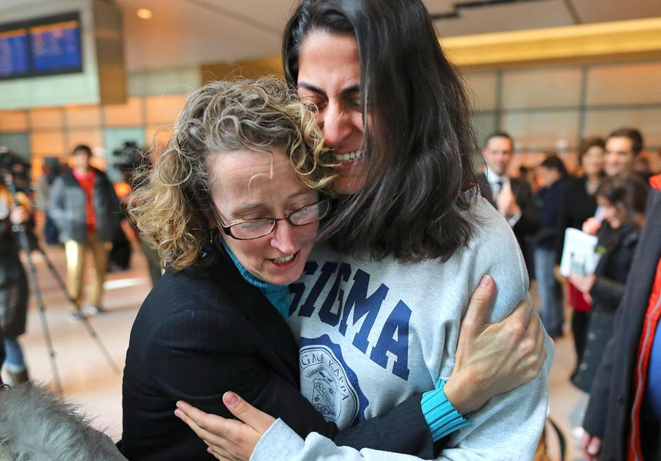 Boston-02/03/2017 . MIT student from Iran, Niki Rahmati cries as she arrives at Logan Airport, as lead attorney Susan Church(left) greeted her. There was a welcoming for arriving refugees and immigrants at Logan Airport international terminal, who were previously not allowed to fly to Boston. John Tlumacki/The Boston Globe(metro)