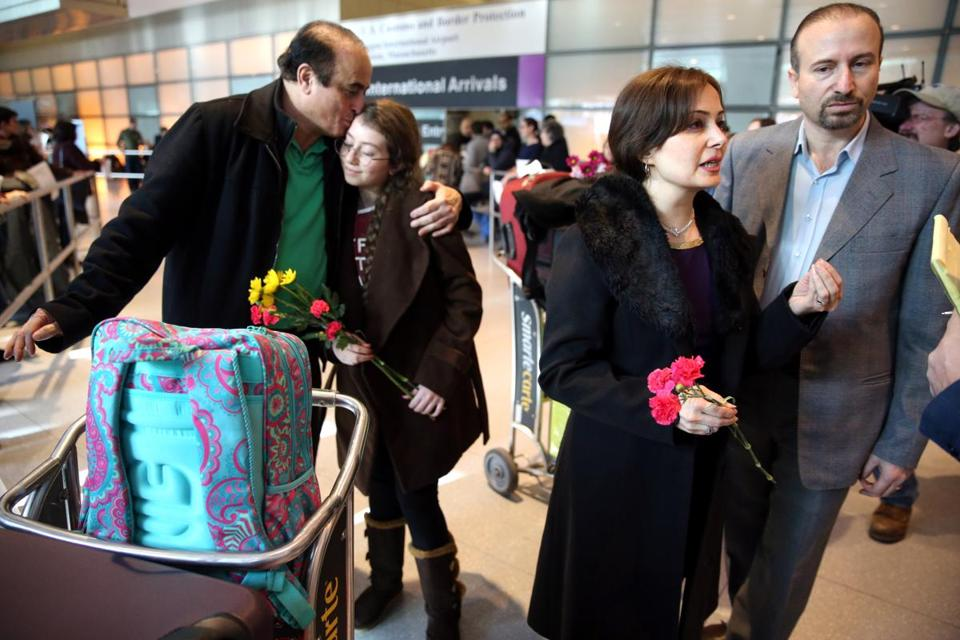 Ali Reza Jalili of Bedford. N.H., greeted his niece Haniya Jalili, 12, while his brother Hamid Reza Jalili and his wife, Baharehsadat Khamesi, spoke with a translator after arriving on a flight from Iran at Logan International Airport.