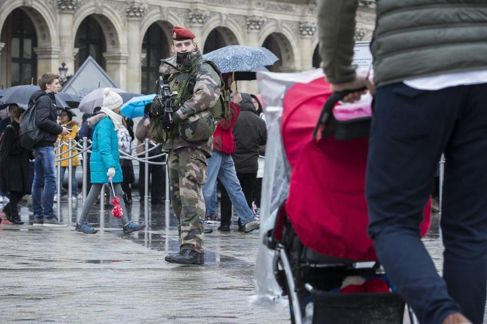 A French soldier was on patrol Saturday in the courtyard of the Louvre in Paris.