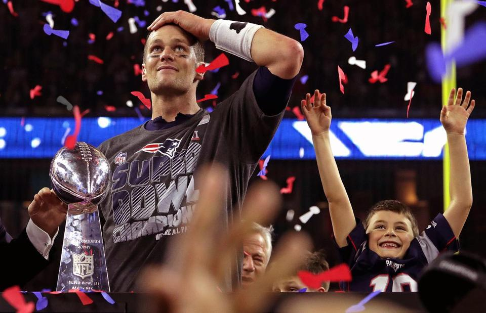 Houston, TX - 2/05/2017 - (4th Quarter/OT) New England Patriots quarterback Tom Brady (12) and his son celebrate with the Lombardi trophy. The Atlanta Falcons play the New England Patriots in Super Bowl LI at NRG Stadium in Houston on Feb. 5, 2017. - (Barry Chin/Globe Staff), Section: Sports, Reporter: Ben Volin, Topic: 06Super Bowl, LOID: 8.3.1481249206.