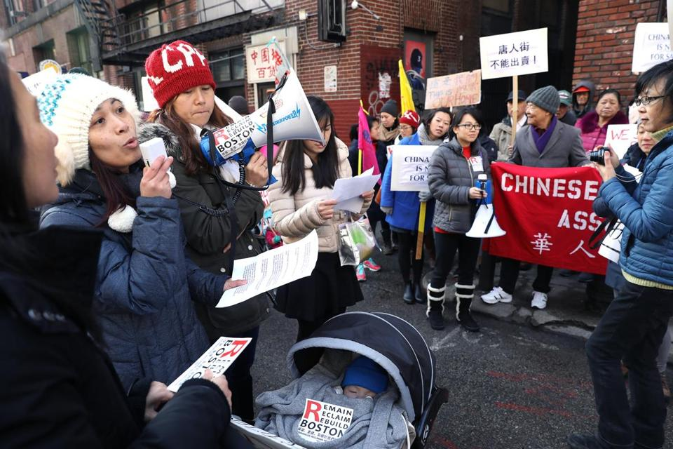 Boston, MA--2/8/2017 - Karen Ng (cq), second from left, addresses the crowd, that included members of the Chinese Progressive Association (cq) and the Boston Chinatown Resident Association (cq). People protest a proposed 26-story hotel in Chinatown, at 25 Harrison Avenue. Photo by Pat Greenhouse/Globe Staff Topic: 09chinatown Reporter: Katheleen Conti