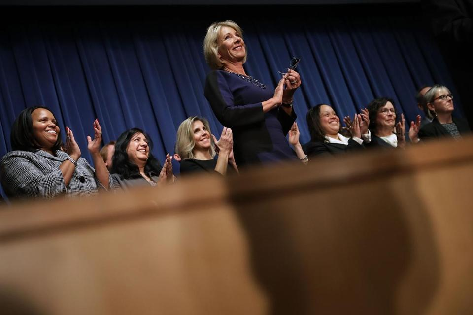 WASHINGTON, DC - FEBRUARY 08: Education Secretary Betsy DeVos joins employees on stage during her first day on the job at the Department of Education February 8, 2017 in Washington, DC. DeVos was confirmed by the Senate after Vice President Mike Pence cast a tie-breaking vote Tuesday. (Photo by Chip Somodevilla/Getty Images)